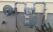 a natural gas meter outside of a house